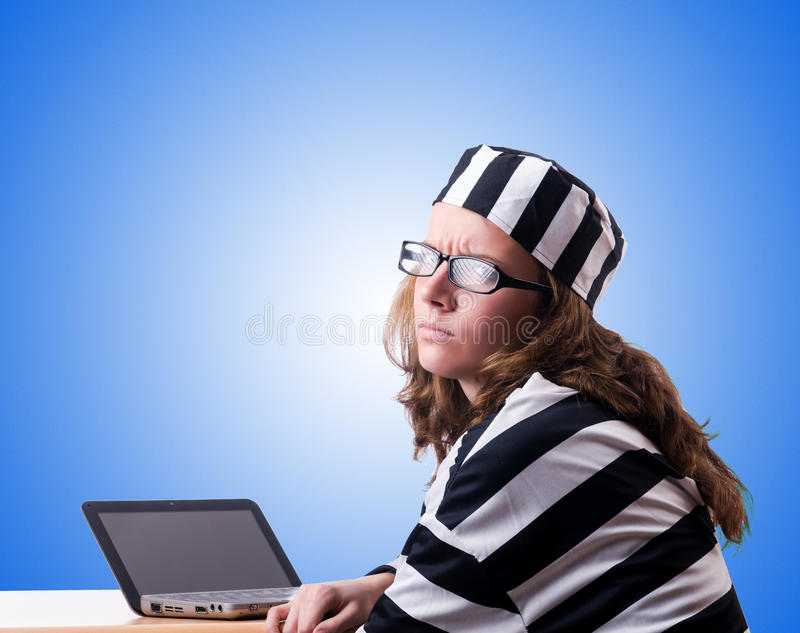 Criminal hacker with laptop against gradient royalty free stock images