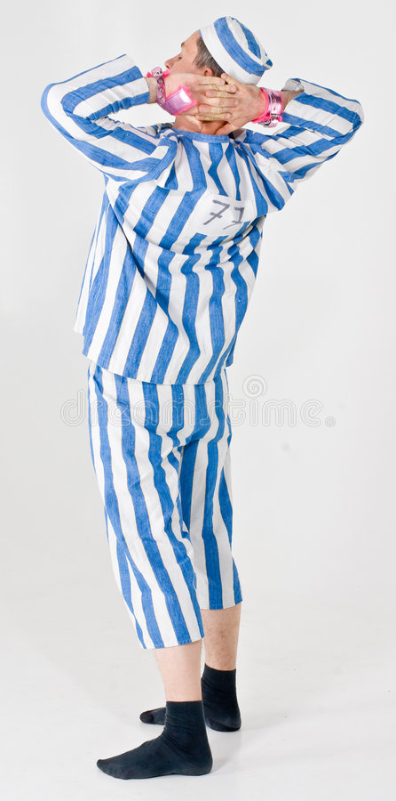 Criminal or prisoner costume. A man wearing a theater costume of a prisoner or criminal stock photo