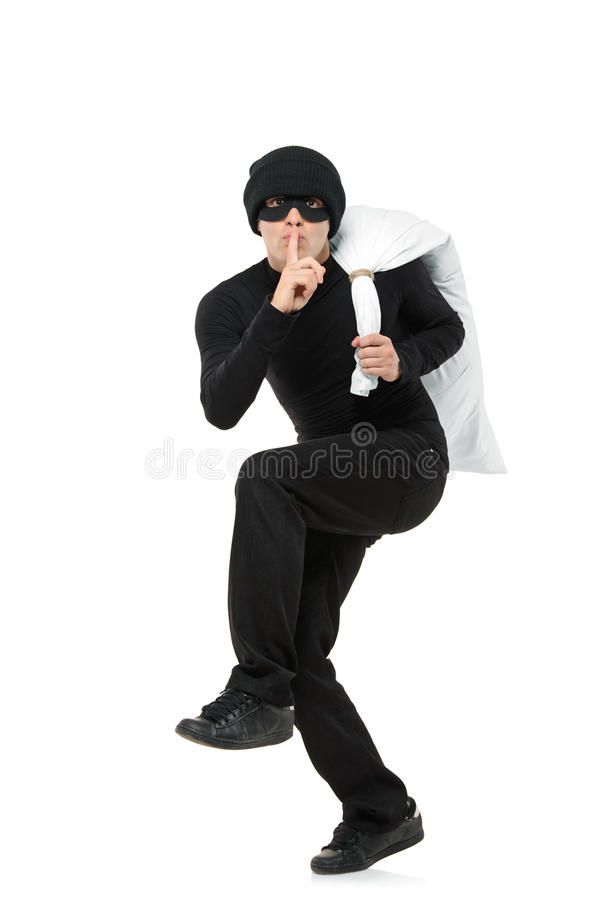 Criminal running away carrying a bag stock images
