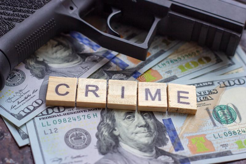 Criminal sign on usa dollars background. Black market, contract killing, mafia and crime concept. royalty free stock image