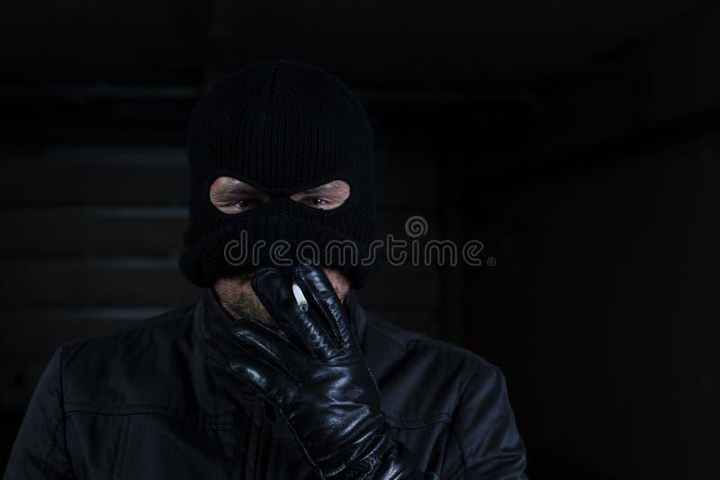 Download Criminal smoking stock image. Image of mask, danger, gangster - 26086053
