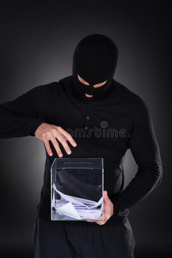 Criminal trying to access ballot box stock images