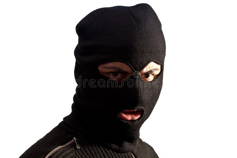 Criminal wearing black mask royalty free stock photo