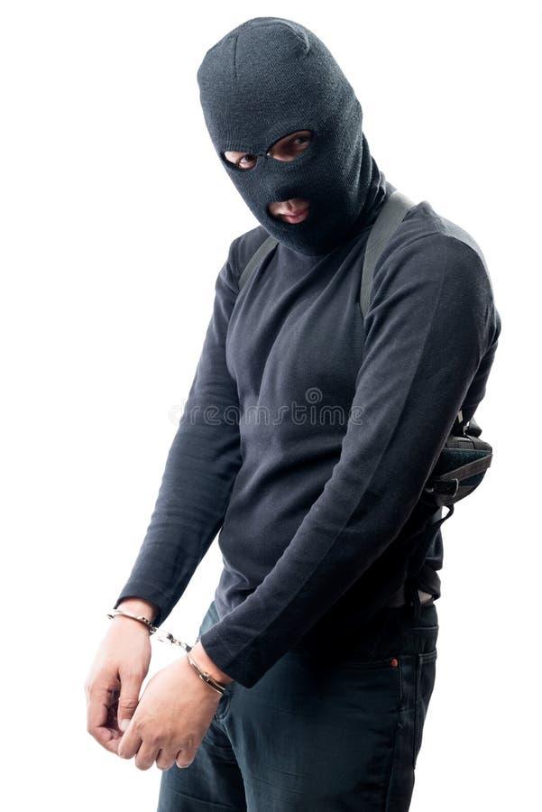 Criminale addolorato in manette arrestate, ritratto fotografia stock