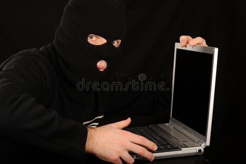 Criminale di Cyber fotografie stock