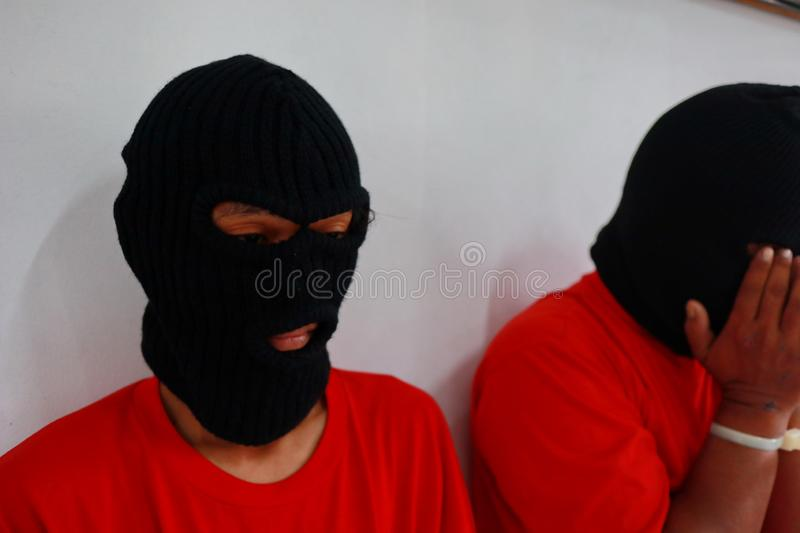 Criminals whose hands are handcuffed, royalty free stock photo