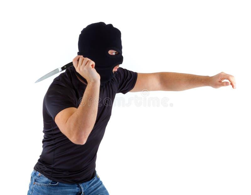 Criminel avec le passe-montagne image stock