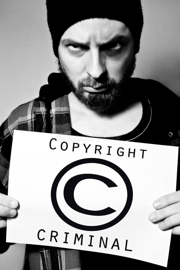 Criminel de copyright image libre de droits
