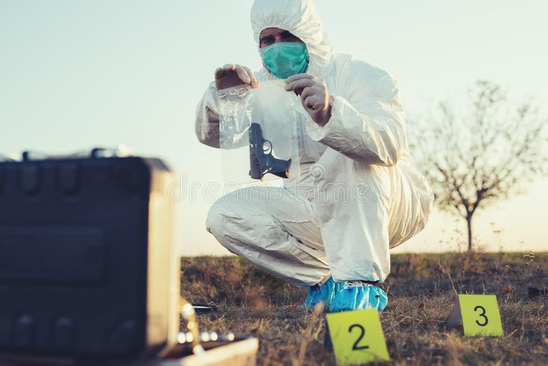 Criminologist investigates a crime scene. stock photography