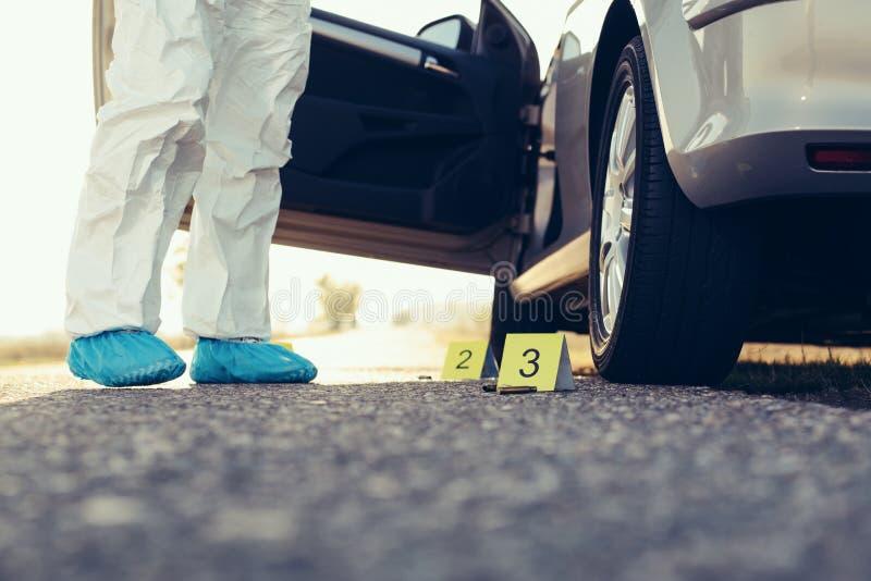 Criminologist investigates a crime scene. stock photos