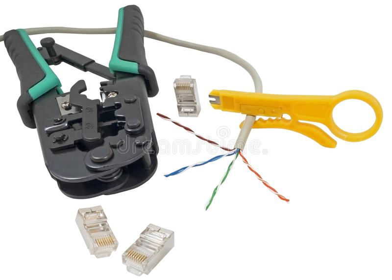 Crimping tool with a network cable isolated royalty free stock photography