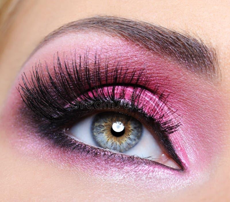 Crimsom make-up eye and long eyelashes royalty free stock image
