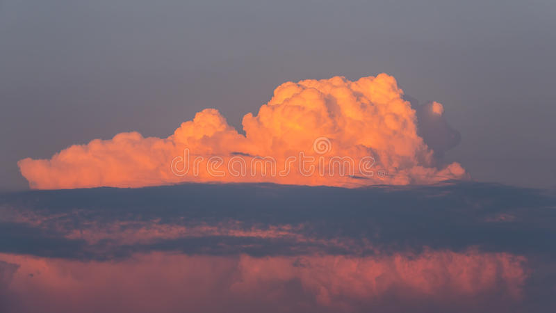 Crimson Blue Clouds. Crimson and pinkish blue clouds just before sunset stock image