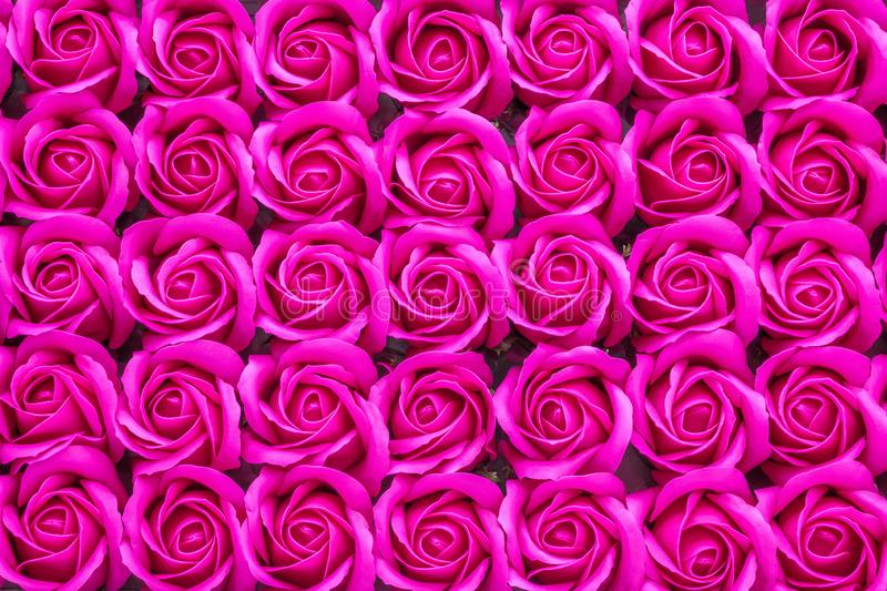 Crimson rose flowers background. Crimson rose flowers made from soap close-up background royalty free stock images
