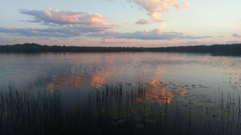 Crimson sunset over the mirror lake. stock photography
