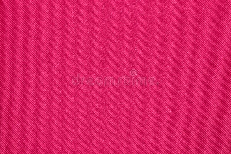 Crimson woven fabric texture. royalty free stock photos