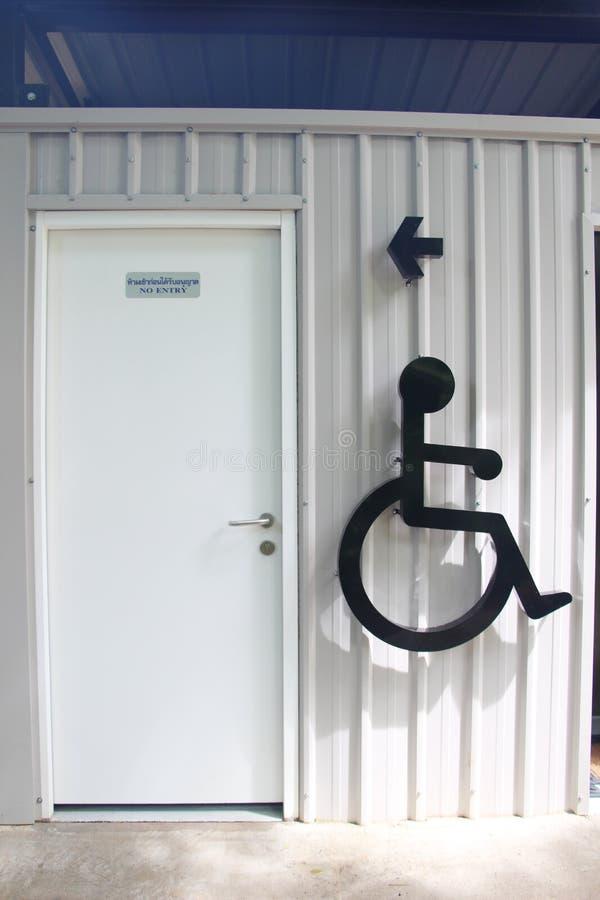 Cripple sign on toilet wall. Stock Photo - cripple sign on toilet wall royalty free stock photos