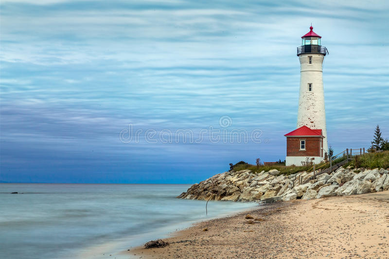 Crips Point Lighthouse at Sundown. The historic Crisp Point Lighthouse, photographed here at sunset on a cloudy day, has stood for over a century in the Lake royalty free stock photos