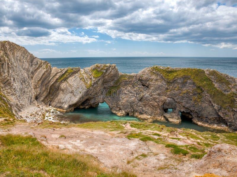 Crique Dorset de Lulworth de trou d'escalier photo libre de droits
