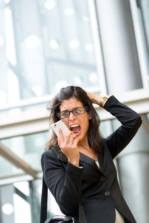 Crise e esforço do negócio da mulher foto de stock