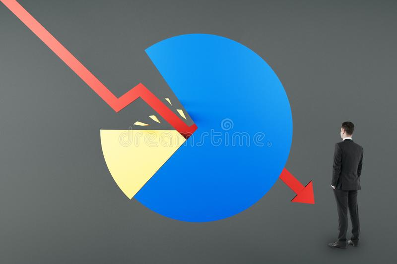 Crisis concept with businessman looking at red arrow breaking business diagram stock photography