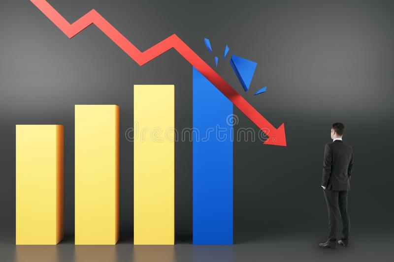 Crisis concept with businessman looking at red arrow breaking business graphs royalty free stock image