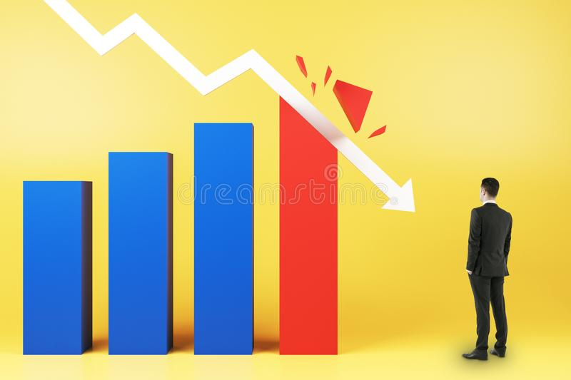 Crisis concept with businessman looking at white arrow breaking business graphs royalty free stock photo