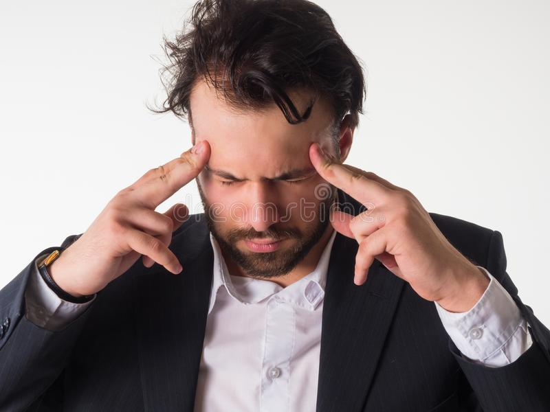 Crisis concept: Overburdened businessman closed eyes with both hands at head and shouting isolated on white background. Crisis concept: Overburdened businessman royalty free stock image