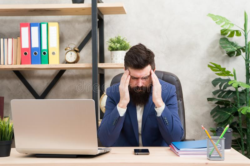Crisis problem. Businessman in formal outfit. Confident man use laptop and smartphone. Boss workplace. Bearded man in stock photo