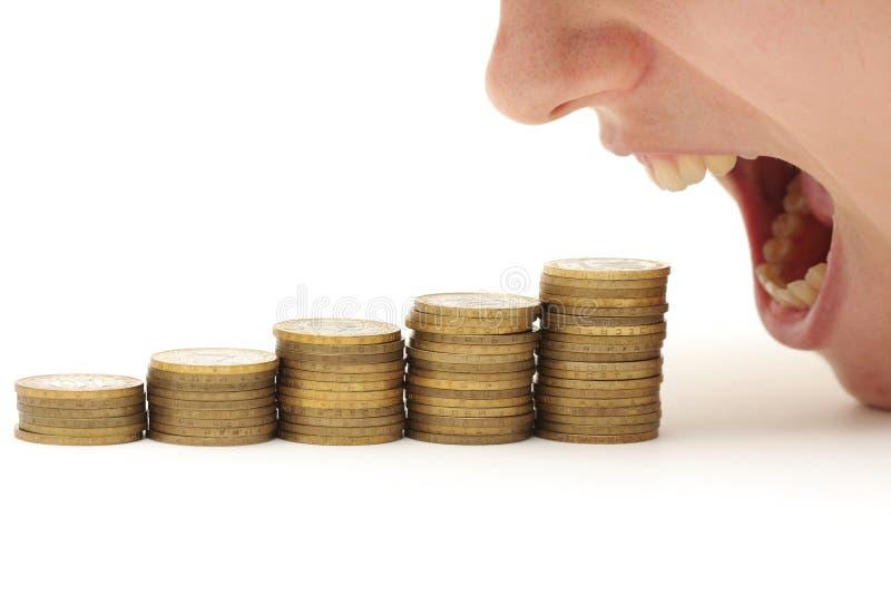 Crisis que come su dinero fotos de archivo libres de regalías