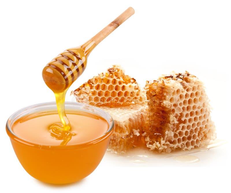 Crisol de la miel y del palillo de madera fotografía de archivo