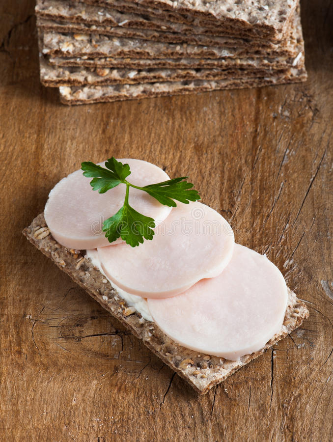 Crisp bread with ham and cream cheese royalty free stock photo