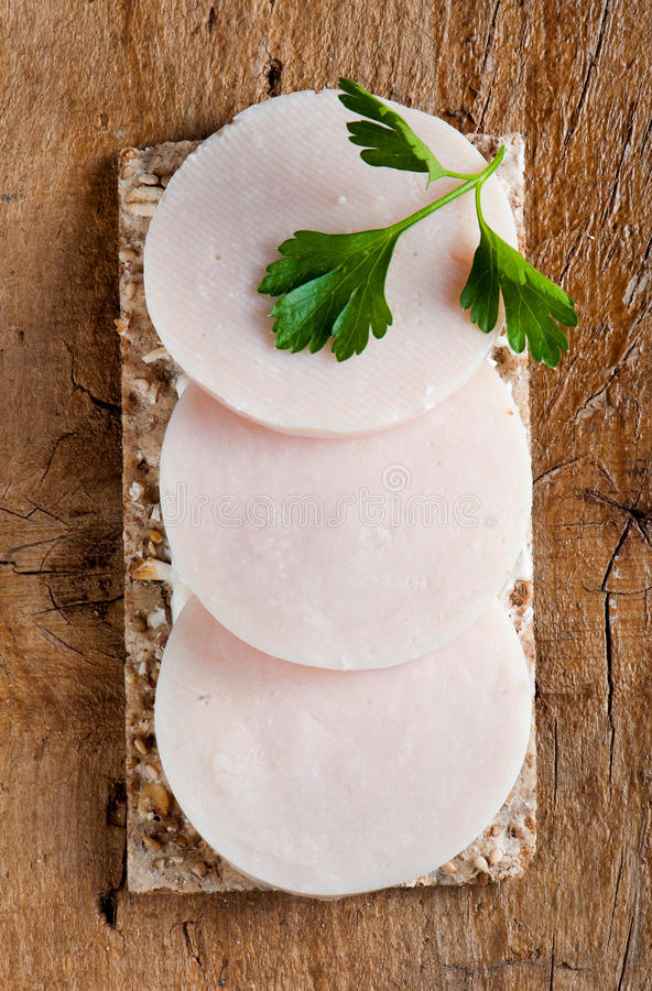 Crisp bread with ham and cream cheese stock image