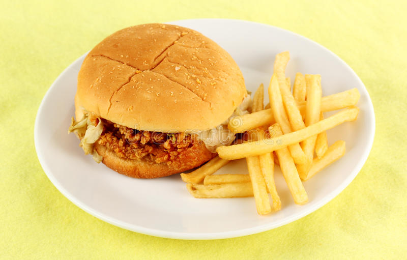 Crisp chicken burger with french fried. On the plate stock photos