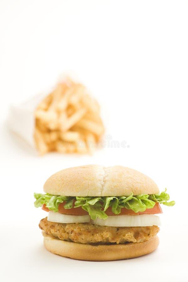 Crisp chicken burger tomato onion cheese lettuce royalty free stock photos
