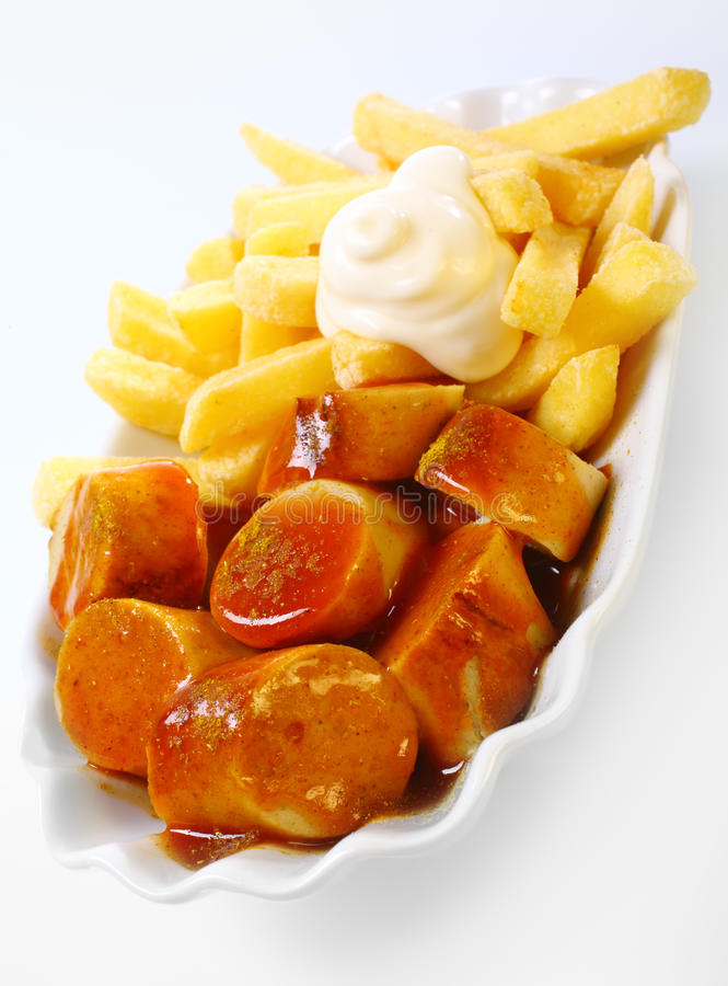 Crisp fried potato chips with spicy currywurst royalty for Creamy sauce served with fish