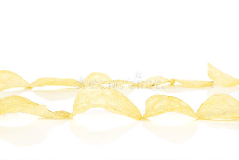 Crisp potato chip isolated on white. Lot of whole crisp potato chip two lines isolated on white background stock photo