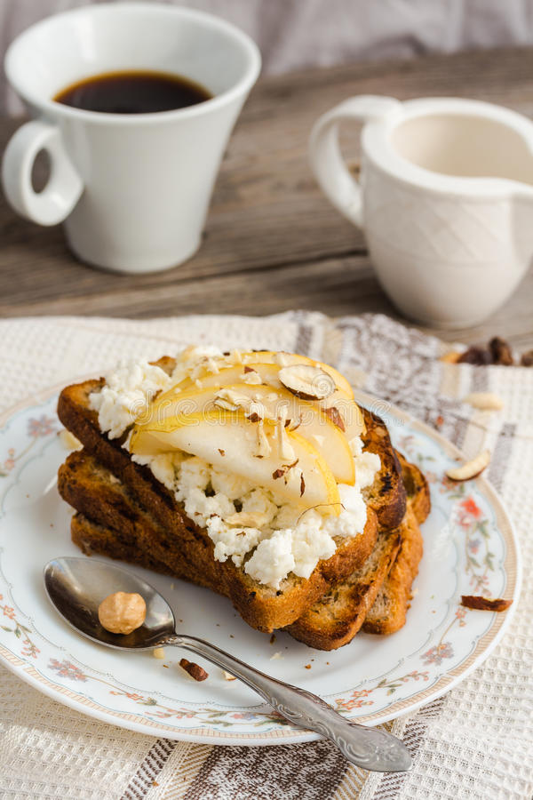 crisp toast for breakfast with sweet cream cheese and pear,coffee stock image