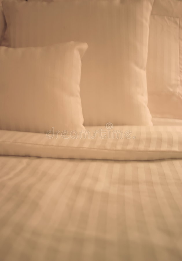 Crisp White Sheets on Bed royalty free stock images