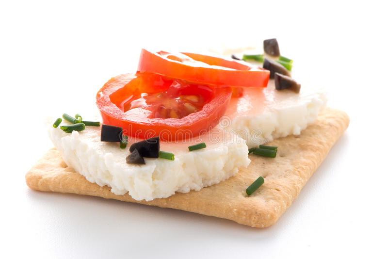 Crispbread with fromage. Tomato and olives isolated on white background stock photography