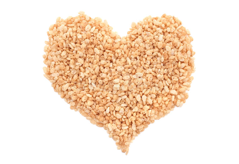 Crisped rice breakfast cereal heart. Crisped rice breakfast cereal in a heart shape, isolated on a white background stock photography