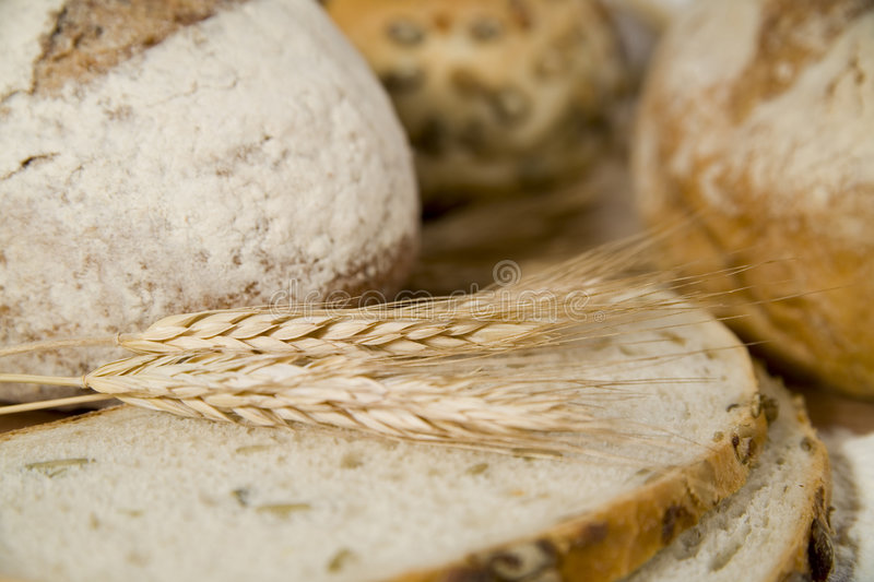 Crispy bread with sour and wheat head royalty free stock photography