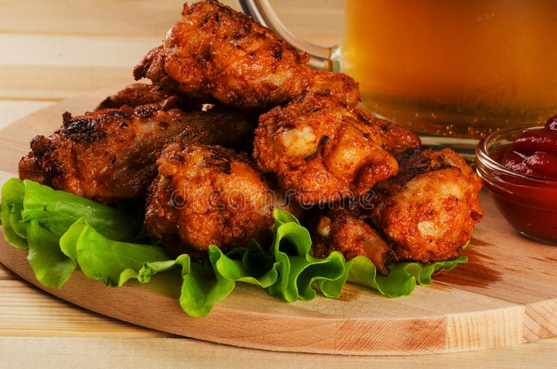 Crispy chicken wings in breadcrumbs stock image