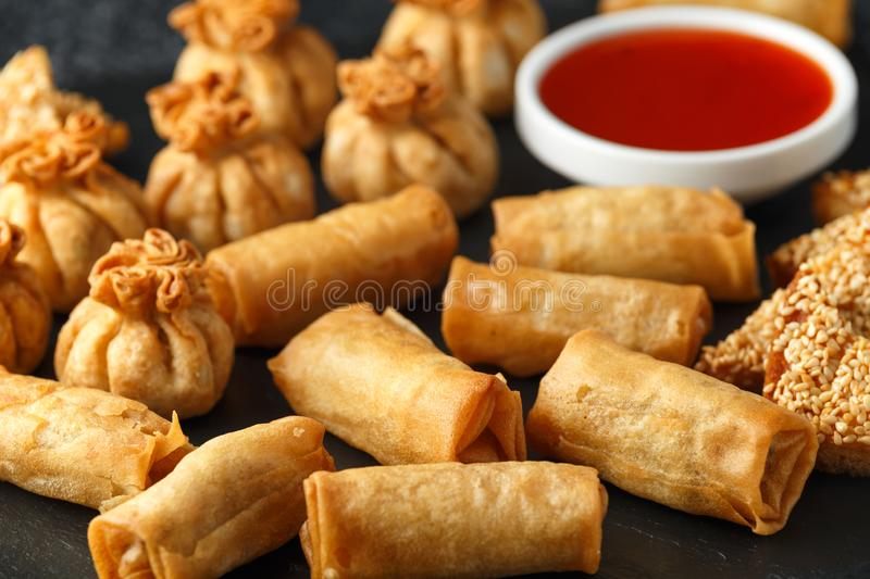 Crispy Chicken wontons, vegetable spring rolls and prawn toasts with sweet chilli sauce. chinese selection. fast food. Crispy Chicken wontons, vegetable spring stock photos