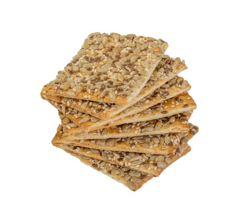 Crispy chleb z ziarnami słonecznik, len i sezamowi ziarna Odizolowywający, obrazy royalty free