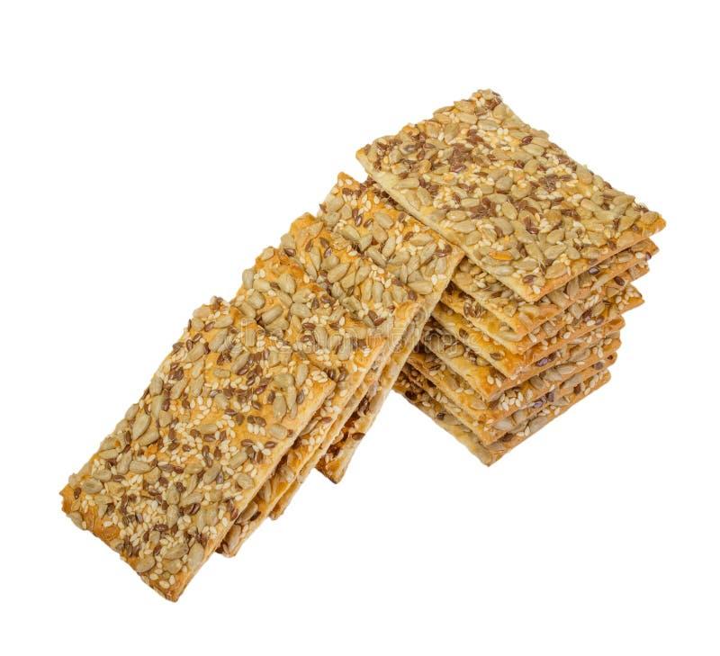 Crispy chleb z ziarnami słonecznik, len i sezamowi ziarna Odizolowywający, zdjęcie royalty free