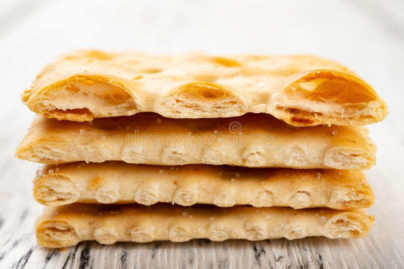 Crispy crackers stacked up & the top cut into half royalty free stock images