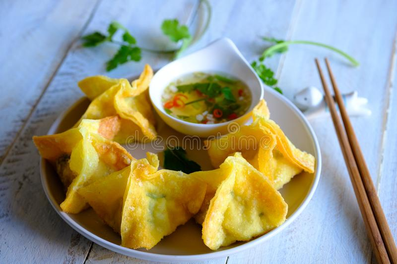 Crispy deep fries Wonton with hot and spicy pork and prawn filling. Centre view. royalty free stock photos