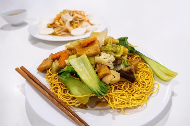 Crispy egg noodles with stir fried vegetables. royalty free stock photos