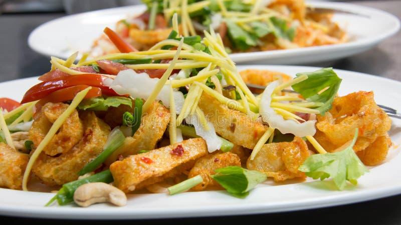Crispy Fish Maw in Spicy Salad stock image